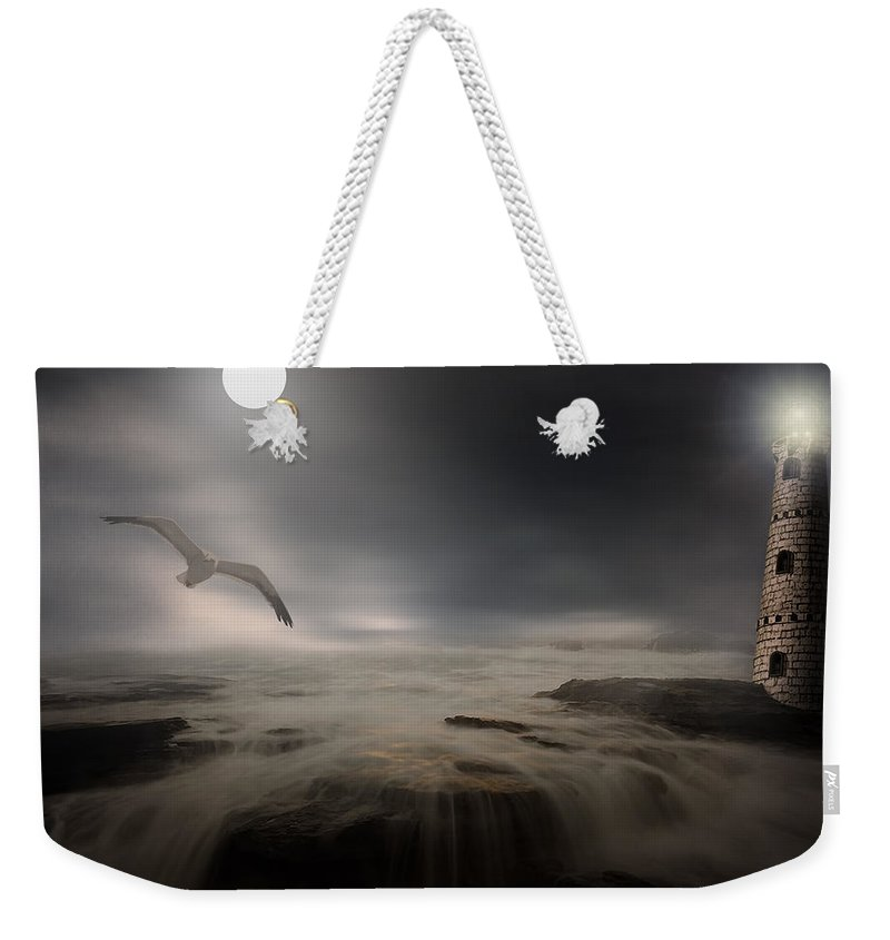 Lighthouse Weekender Tote Bag featuring the photograph Moonlight Lighthouse by Lourry Legarde