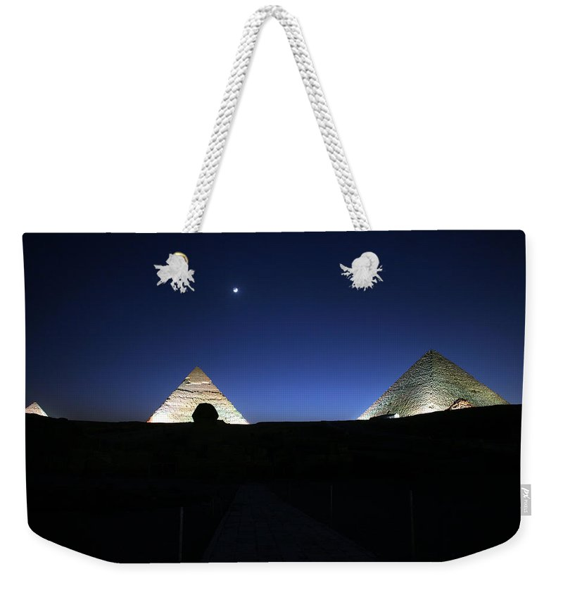 Moonlight Weekender Tote Bag featuring the photograph Moonlight Over 3 Pyramids by Donna Corless