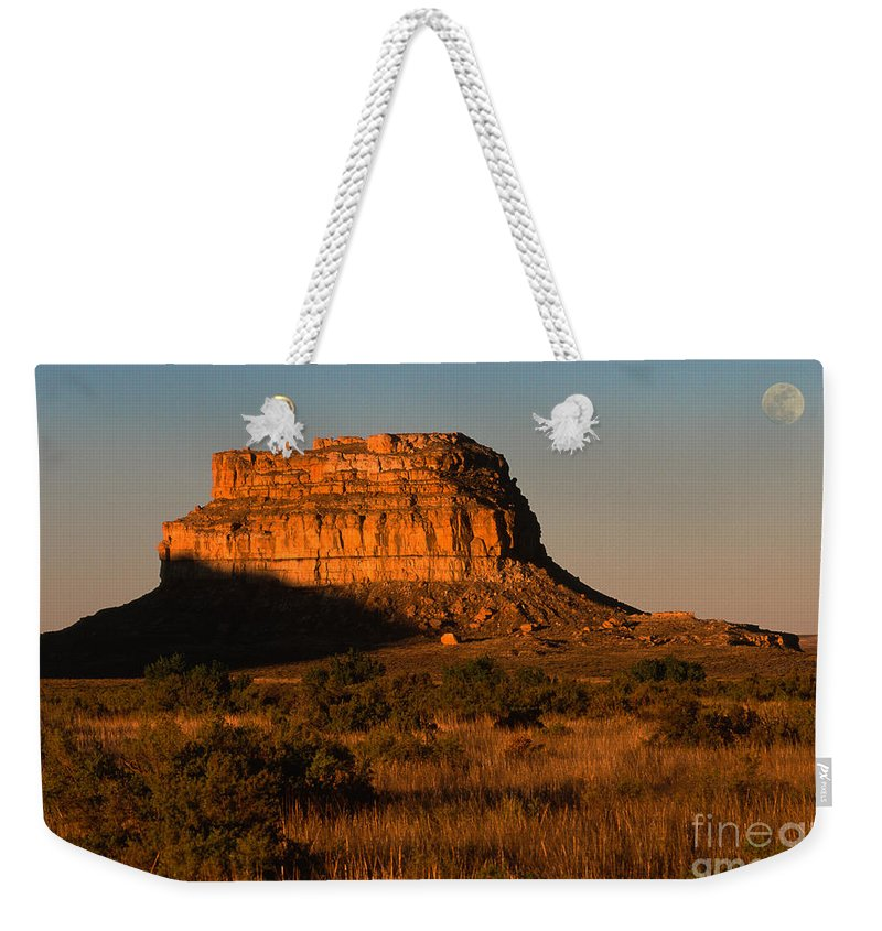 New Mexico Weekender Tote Bag featuring the photograph Moonset At Fajada Butte by Sandra Bronstein