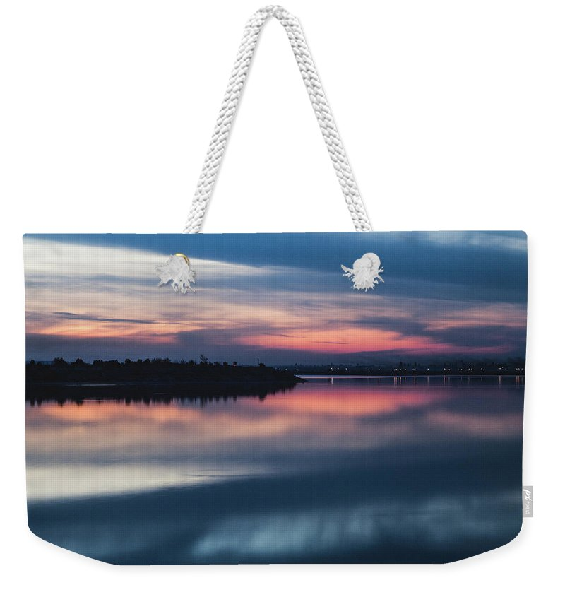 Sunset Weekender Tote Bag featuring the photograph Morii Lake At Sunset by Eduard Stoica