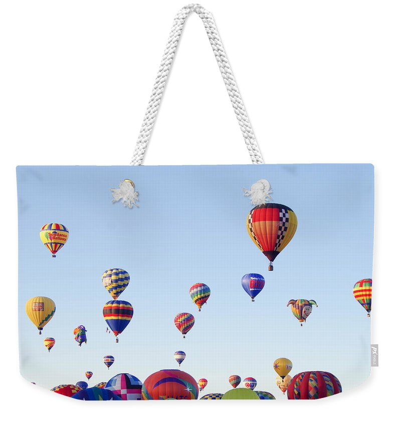 Hot Air Balloons Weekender Tote Bag featuring the photograph Morning Ballon Rise by Mike Wheeler