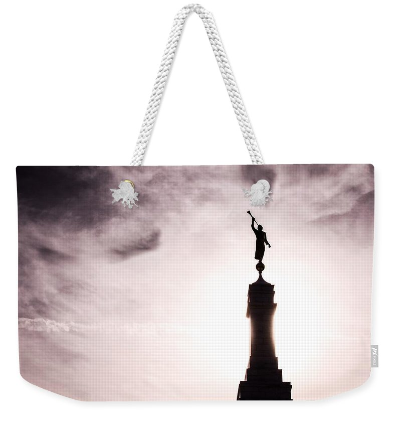 Weekender Tote Bag featuring the photograph Moroni Silhouette Over Louisville by Quinn James