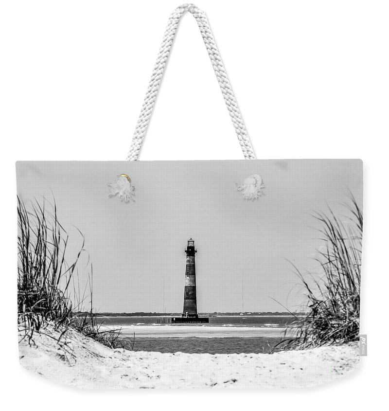 Morris Weekender Tote Bag featuring the photograph Morris Island Lighthouse Horizons by Yvette Wilson
