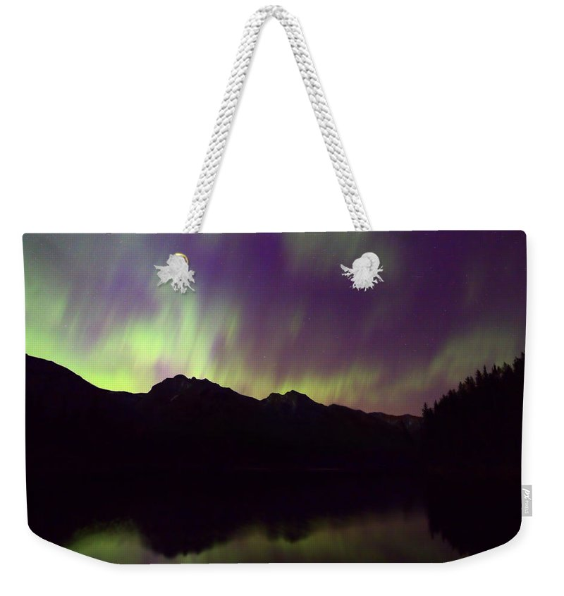 Johnson Lake Weekender Tote Bag featuring the photograph Mother Natures Fireworks by James Anderson