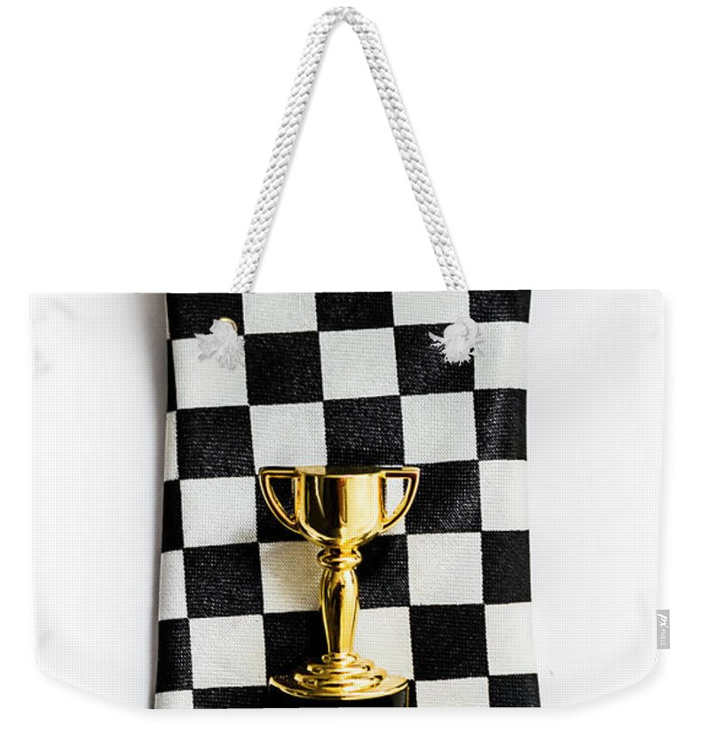 1st Weekender Tote Bag featuring the photograph Motor Sport Racing Tie And Trophy by Jorgo Photography - Wall Art Gallery
