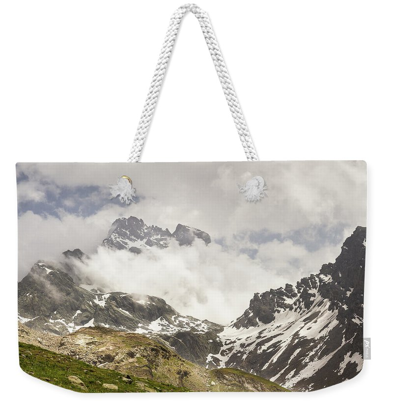 Mountain Landscape Weekender Tote Bag featuring the photograph Mount Viso In The Clouds by Paul MAURICE