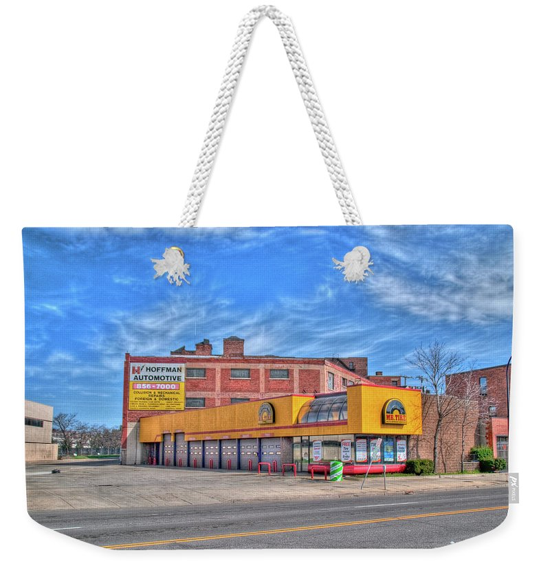 Buildings Weekender Tote Bag featuring the photograph Mr Tire 15117 by Guy Whiteley