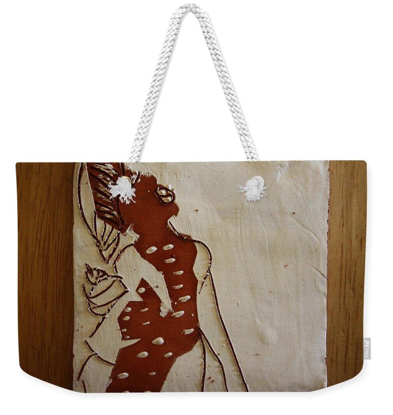 Jesus Weekender Tote Bag featuring the ceramic art Mums Parcel - Tile by Gloria Ssali