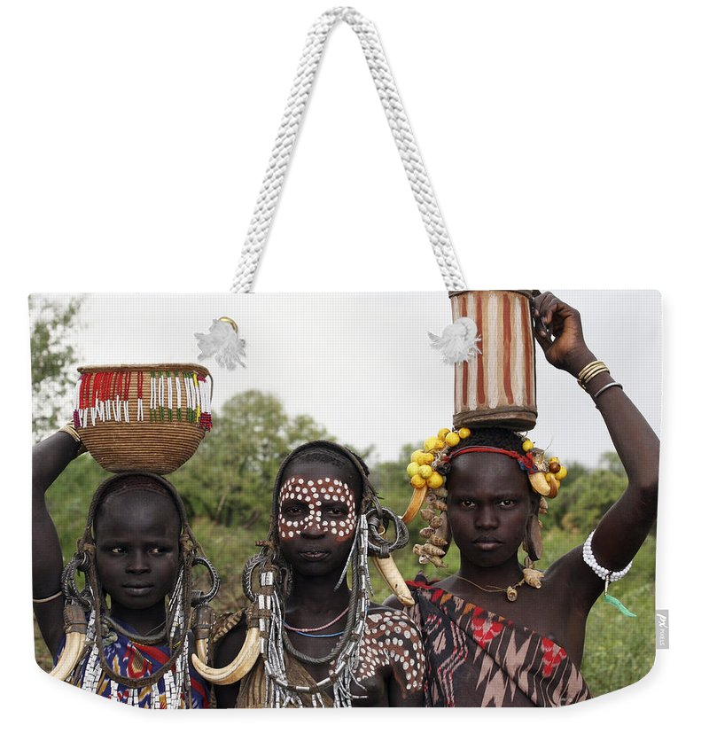Ethiopia Weekender Tote Bag featuring the photograph Mursi Tribesmen In Ethiopia by Gilad Flesch