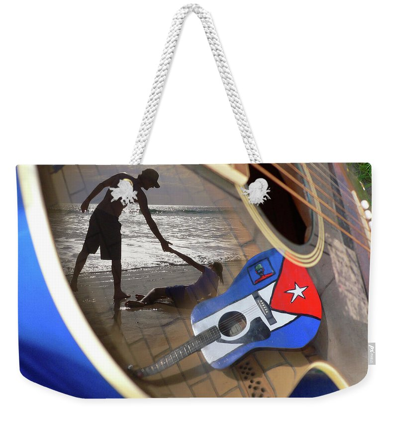 Music Weekender Tote Bag featuring the photograph Music By The Sea by Kelly Jade King