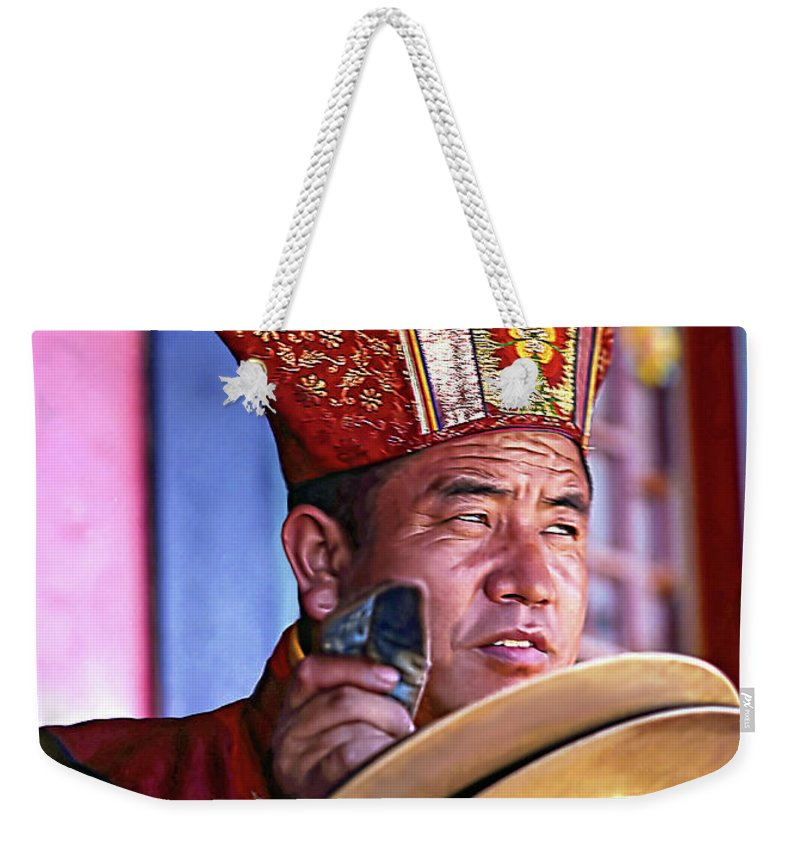 Buddhism Weekender Tote Bag featuring the photograph Musical Monk by Steve Harrington