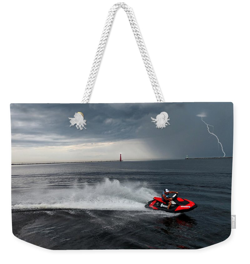 Jet Ski Weekender Tote Bag featuring the photograph Muskegon South Pier Lighthouse by Michael Rucker