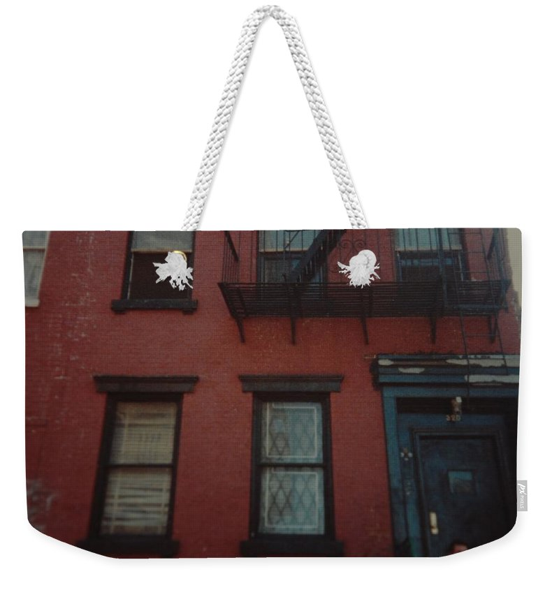 Lower East Side Weekender Tote Bag featuring the photograph My Pops First Home In The United States by Rob Hans