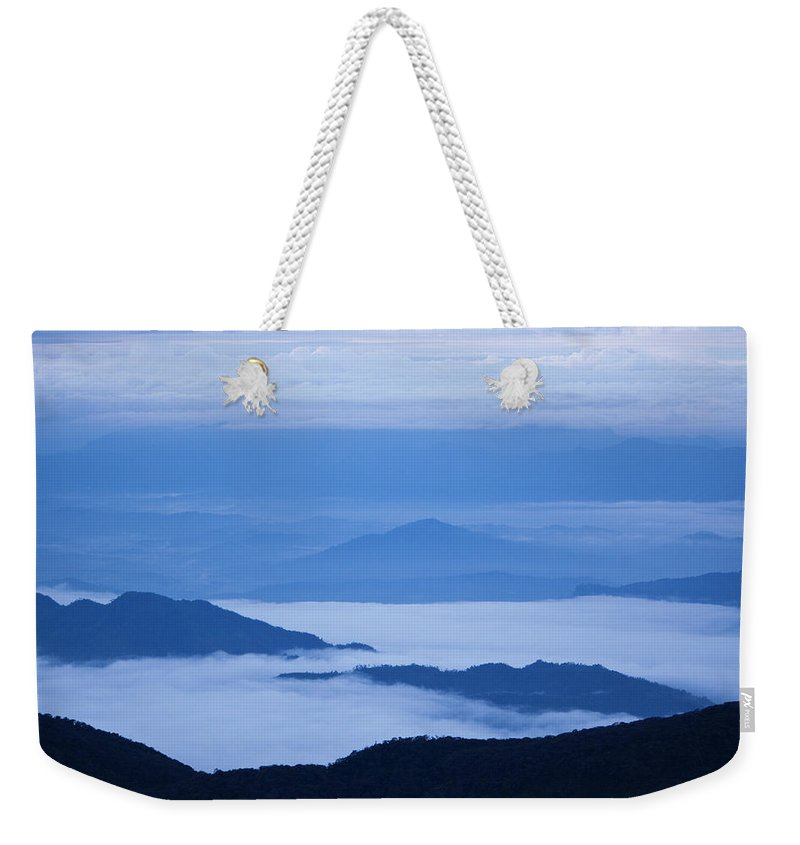 View Weekender Tote Bag featuring the photograph Mystique by Andrew Paranavitana