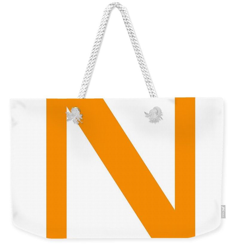 N Weekender Tote Bag featuring the digital art N In Tangerine Typewriter Style by Custom Home Fashions