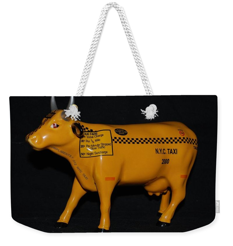 Macro Weekender Tote Bag featuring the photograph N Y C Taxi Cow by Rob Hans
