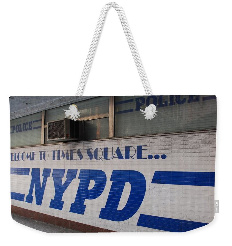 Nypd Weekender Tote Bag featuring the photograph N Y P D Blue by Rob Hans