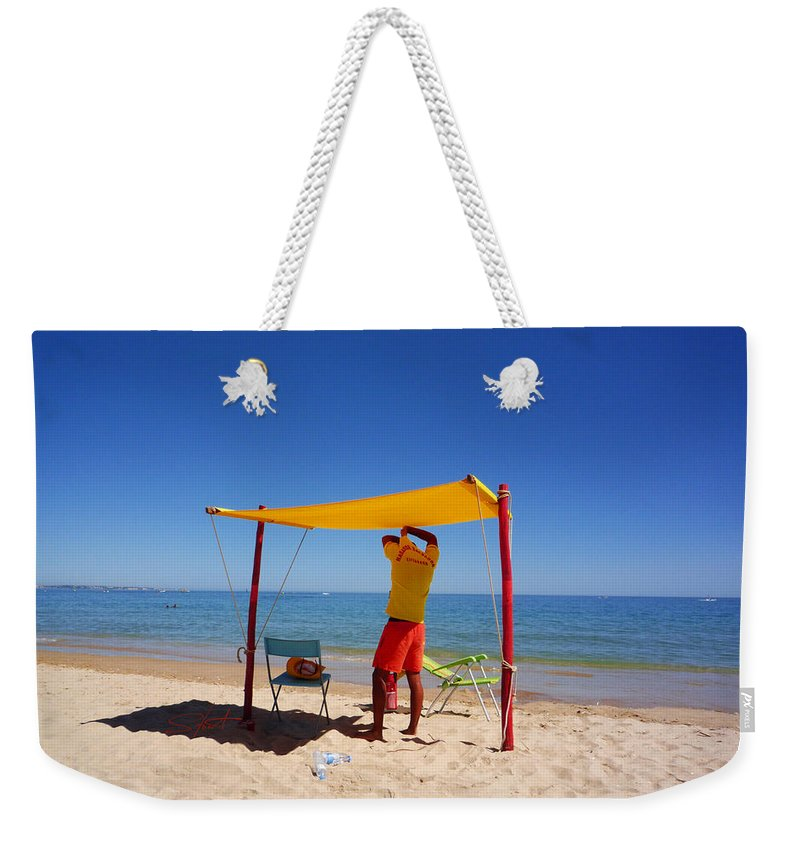Life Guard Weekender Tote Bag featuring the photograph Nadador Salvador by Charles Stuart