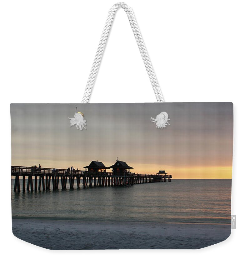 Florida Weekender Tote Bag featuring the photograph Naples Pier - Golden Hour At The Pier by Ronald Reid