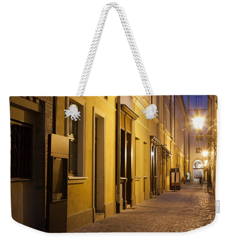 Wroclaw Weekender Tote Bag featuring the photograph Narrow Street In Old Town Of Wroclaw In Poland by Artur Bogacki