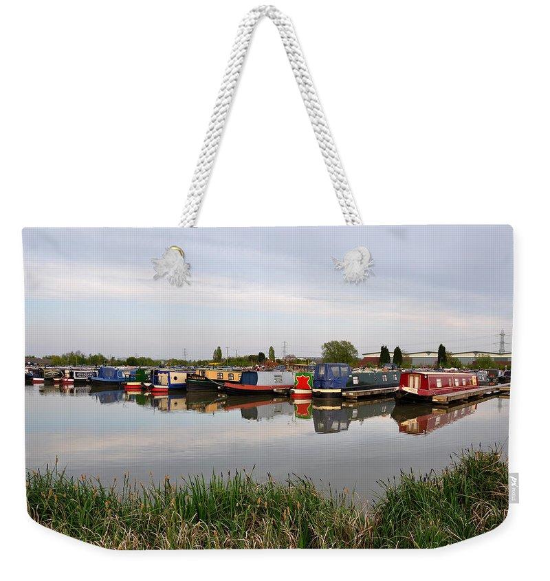 Reflections Weekender Tote Bag featuring the photograph Narrowboats At Barton Marina by Rod Johnson