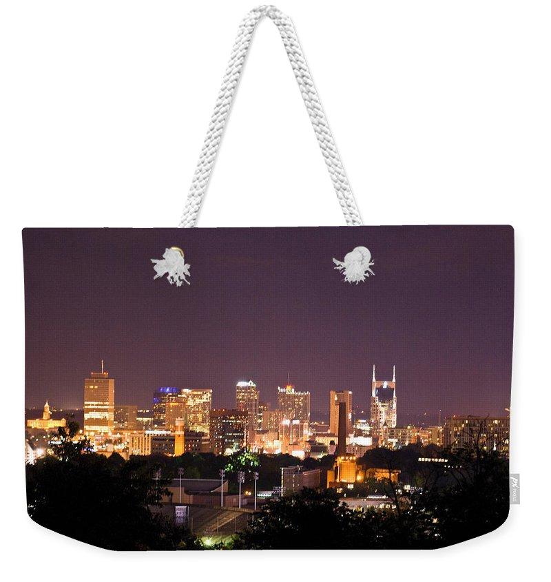 Nashville Weekender Tote Bag featuring the photograph Nashville Night Scene by Douglas Barnett