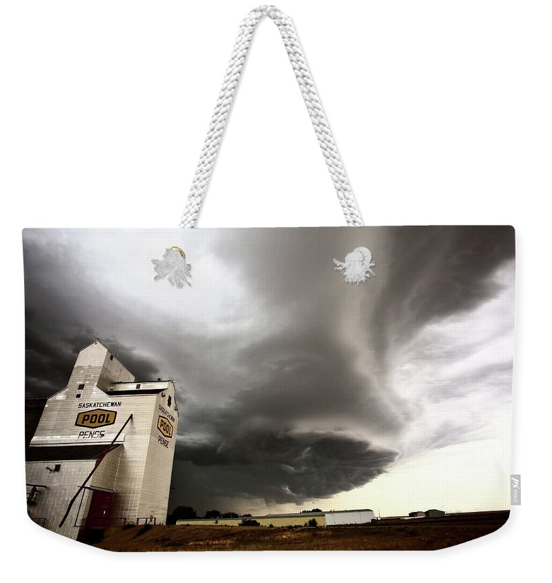 Grain Elevator Weekender Tote Bag featuring the digital art Nasty Looking Cumulonimbus Cloud Behind Grain Elevator by Mark Duffy