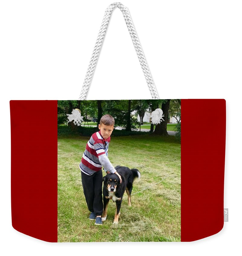 Nathan Weekender Tote Bag featuring the photograph Nathan Loves Bailey by Bryann Cole
