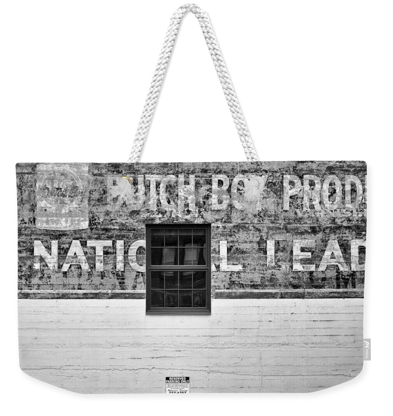 Urban Weekender Tote Bag featuring the photograph National Lead - Portland, Oregon by Jim Bourne