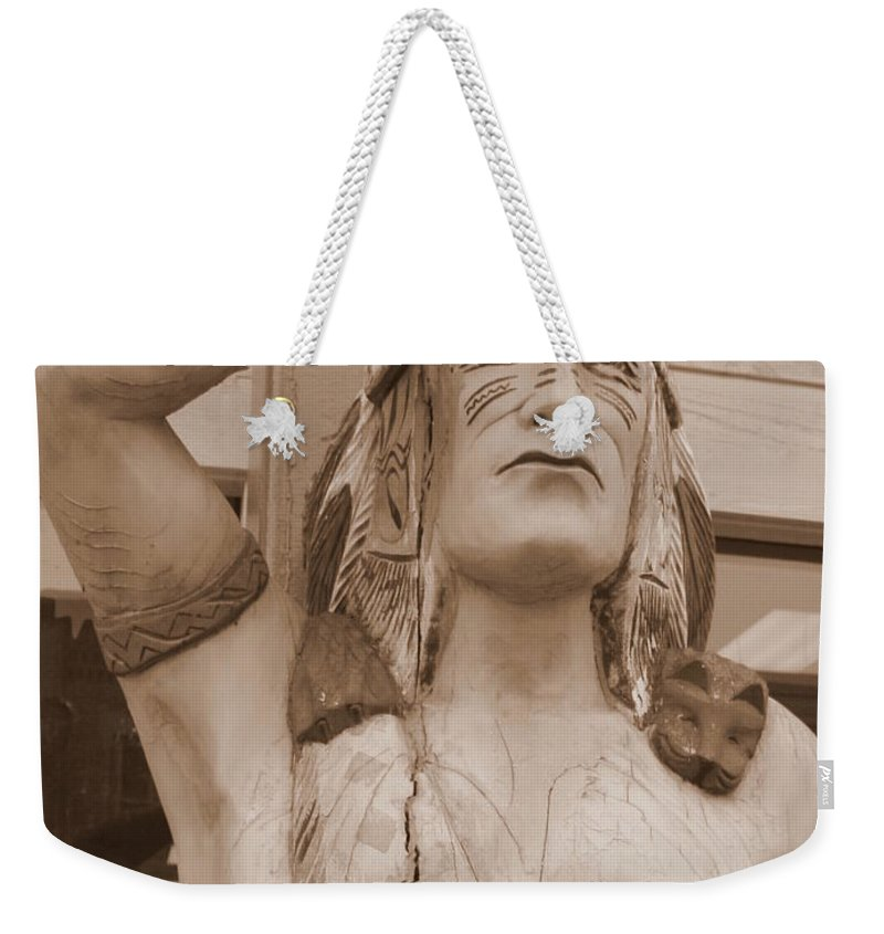 Native American Weekender Tote Bag featuring the photograph Native American Statue In Toppenish by Carol Groenen