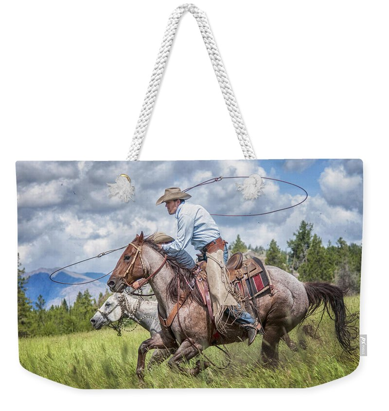 Lasso Weekender Tote Bag featuring the photograph Neck And Neck by Claudia Kuhn