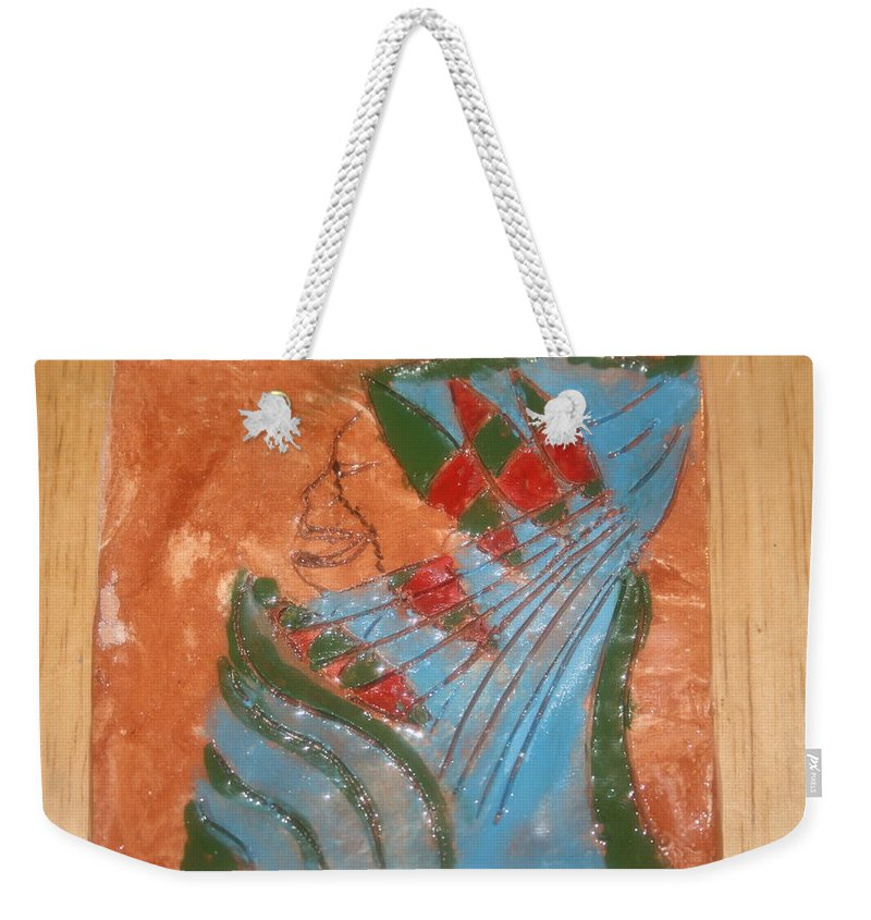 Jesus Weekender Tote Bag featuring the ceramic art Need More Candy - Tile by Gloria Ssali