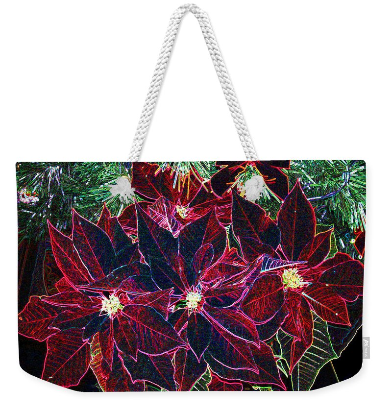 Flowers Weekender Tote Bag featuring the photograph Neon Poinsettias by Nancy Mueller