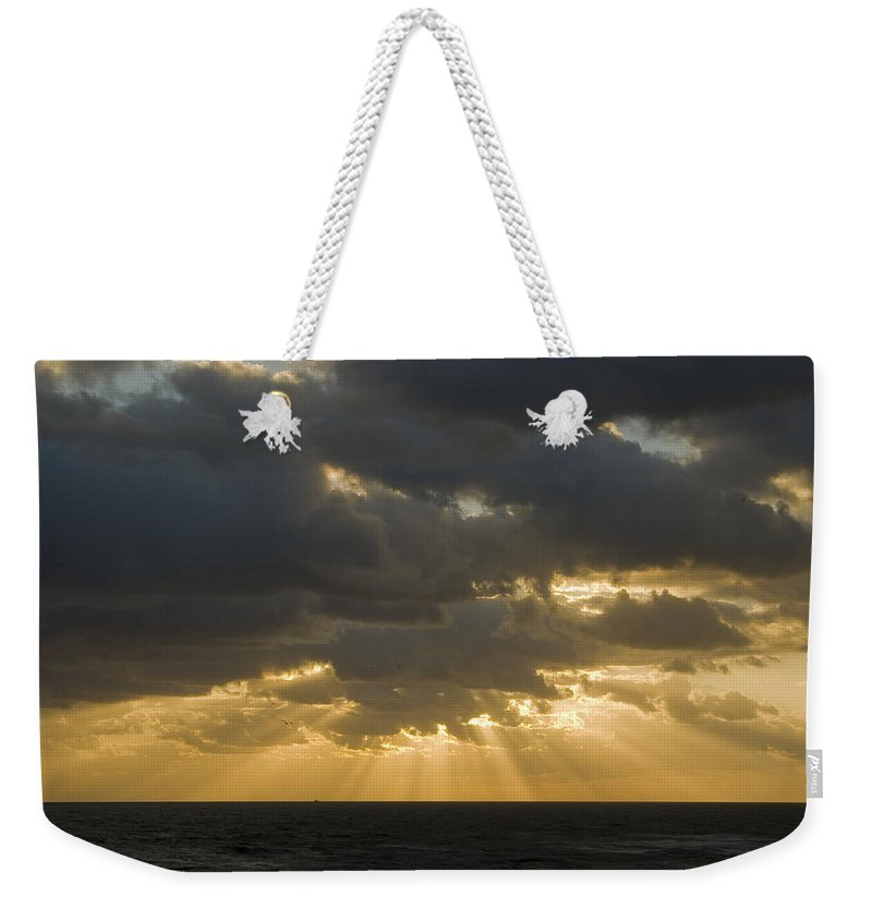 Ocean Sunset Sun Cloud Clouds Ray Rays Beam Beams Bright Wave Waves Water Sea Beach Golden Nature Weekender Tote Bag featuring the photograph New Beginning by Andrei Shliakhau