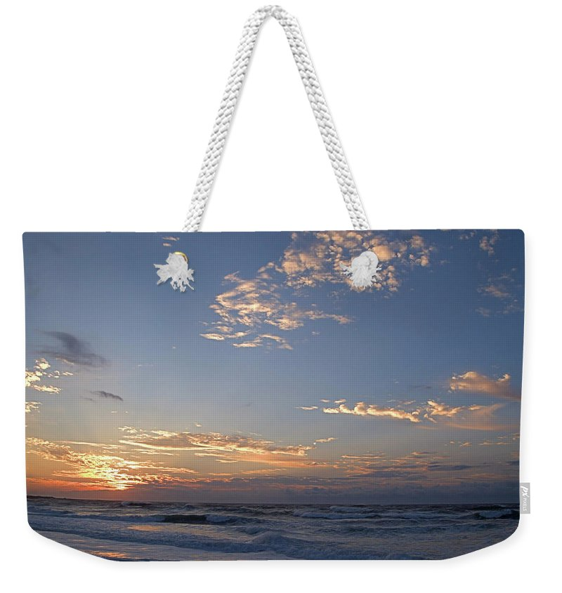 Seas Weekender Tote Bag featuring the photograph New Dawn by Newwwman