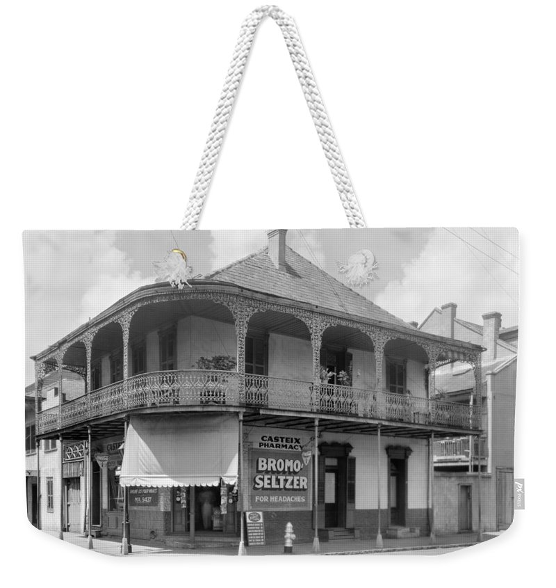 1938 Weekender Tote Bag featuring the photograph New Orleans Pharmacy by The Granger Collection