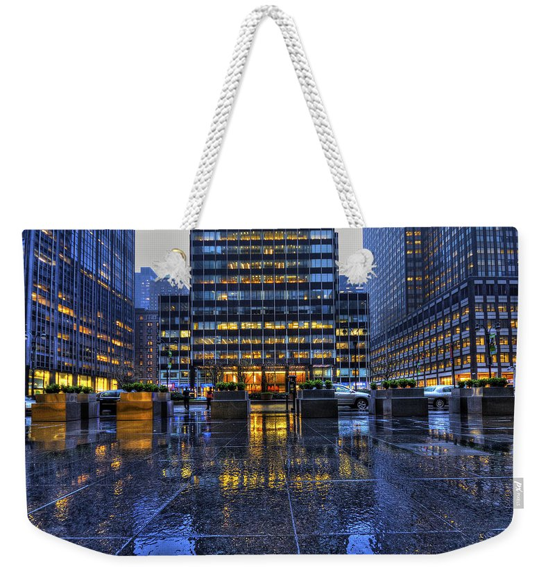 New York Weekender Tote Bag featuring the photograph New York Blues by Evelina Kremsdorf