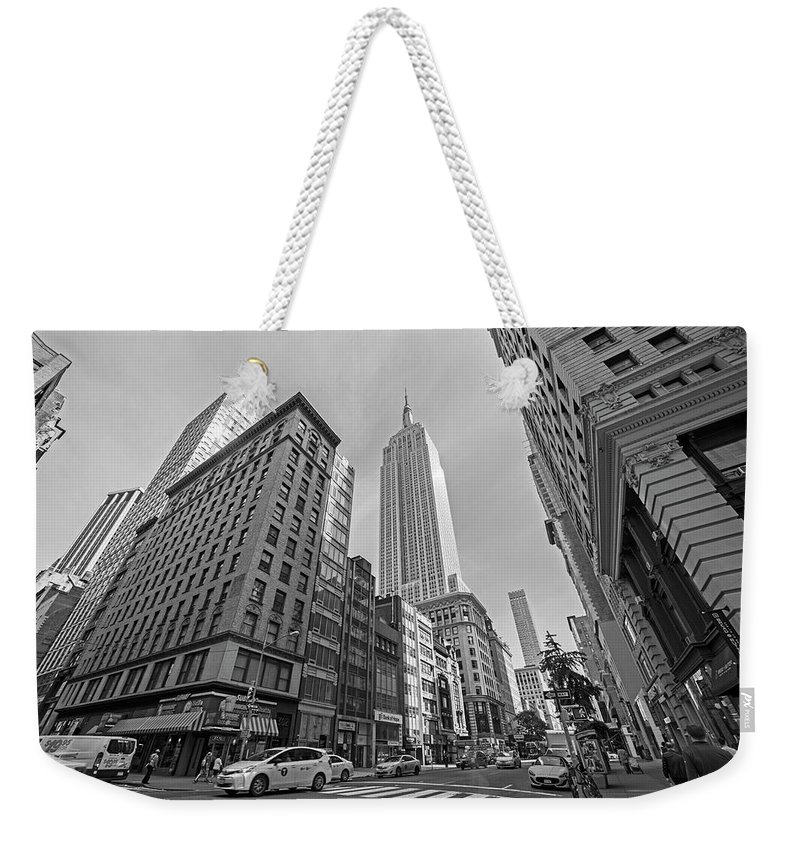 New Weekender Tote Bag featuring the photograph New York Fifth Avenue Taxis Empire State Building Black And White by Toby McGuire