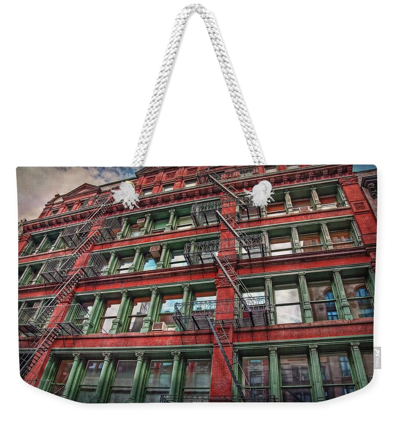 New York Weekender Tote Bag featuring the photograph New York Fire Escapes by Hanny Heim