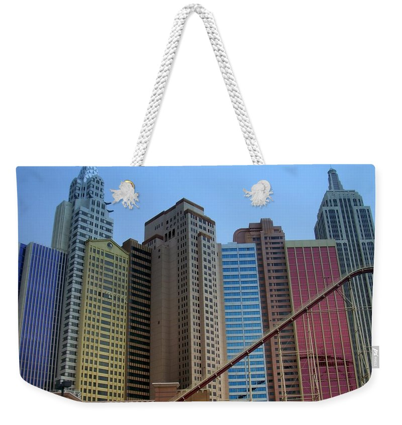 Vegas Weekender Tote Bag featuring the photograph New York Hotel by Anita Burgermeister
