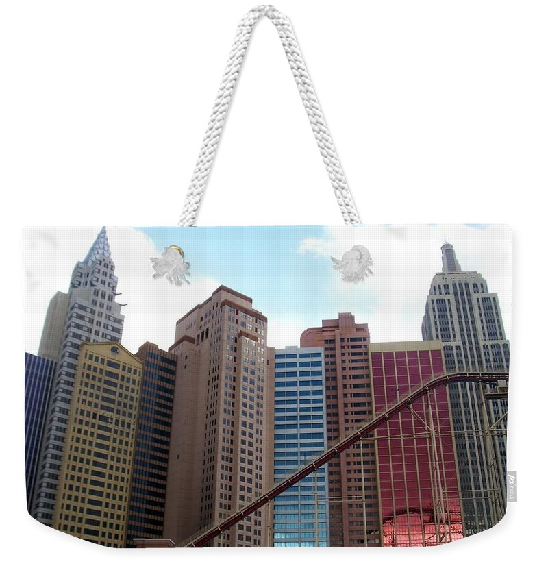 Vegas Weekender Tote Bag featuring the photograph New York Hotel With Clouds by Anita Burgermeister