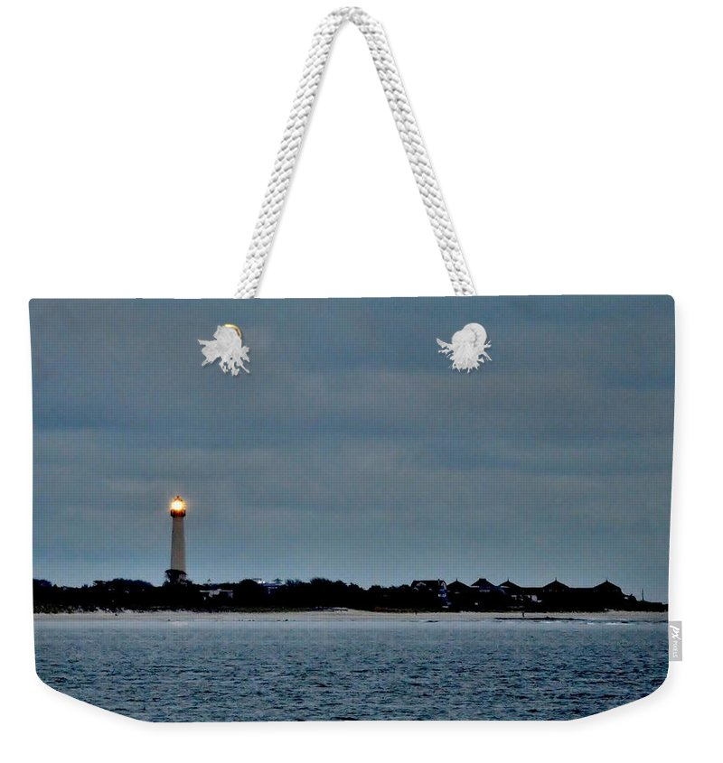 Lighthouse Weekender Tote Bag featuring the photograph Night Beacon - Cape May Lighthouse by Kim Bemis