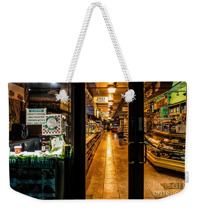 New York Weekender Tote Bag featuring the photograph Night Deli by M G Whittingham