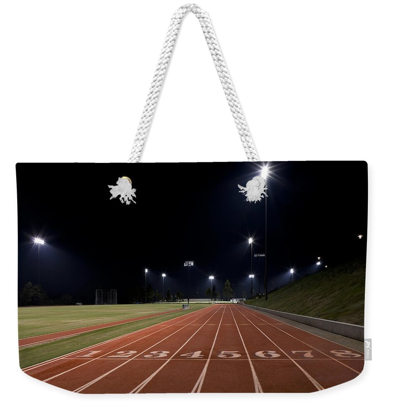 Sports Weekender Tote Bag featuring the photograph Night Time Run by Kelley King