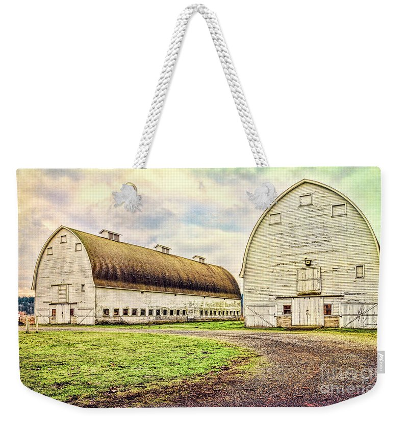 Nisqually Weekender Tote Bag featuring the photograph Nisqually Twin Barns by Jean OKeeffe Macro Abundance Art