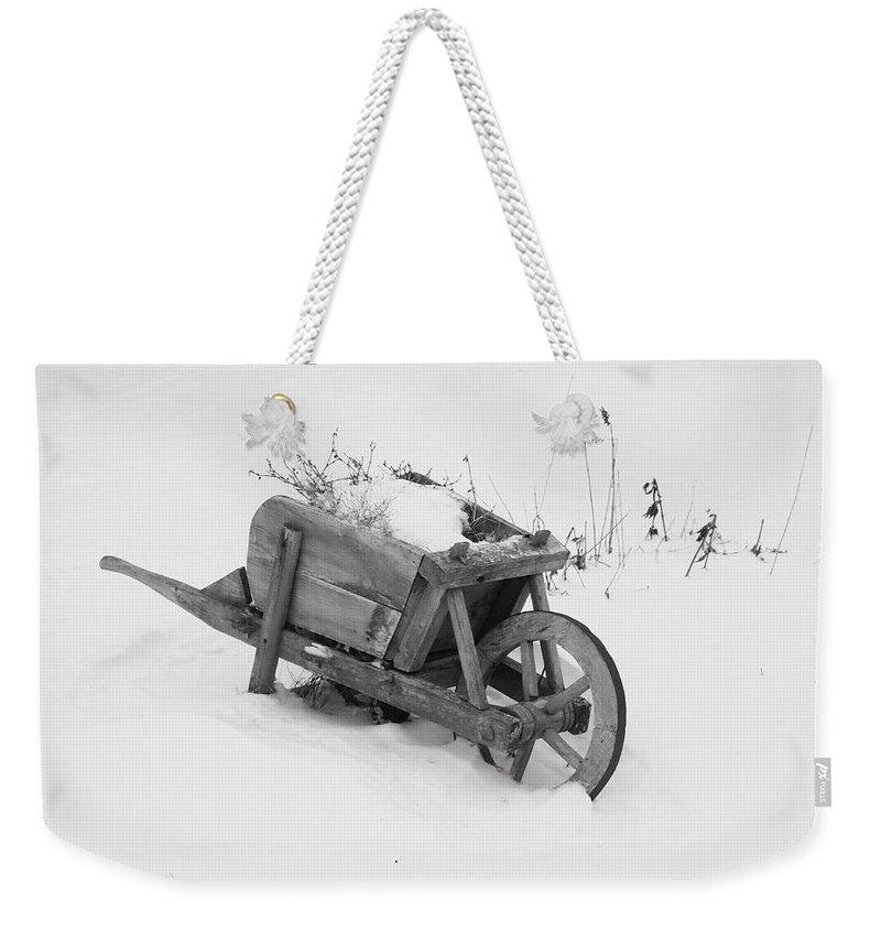 Garden Weekender Tote Bag featuring the photograph No Gardening Yet by Rod Stewart