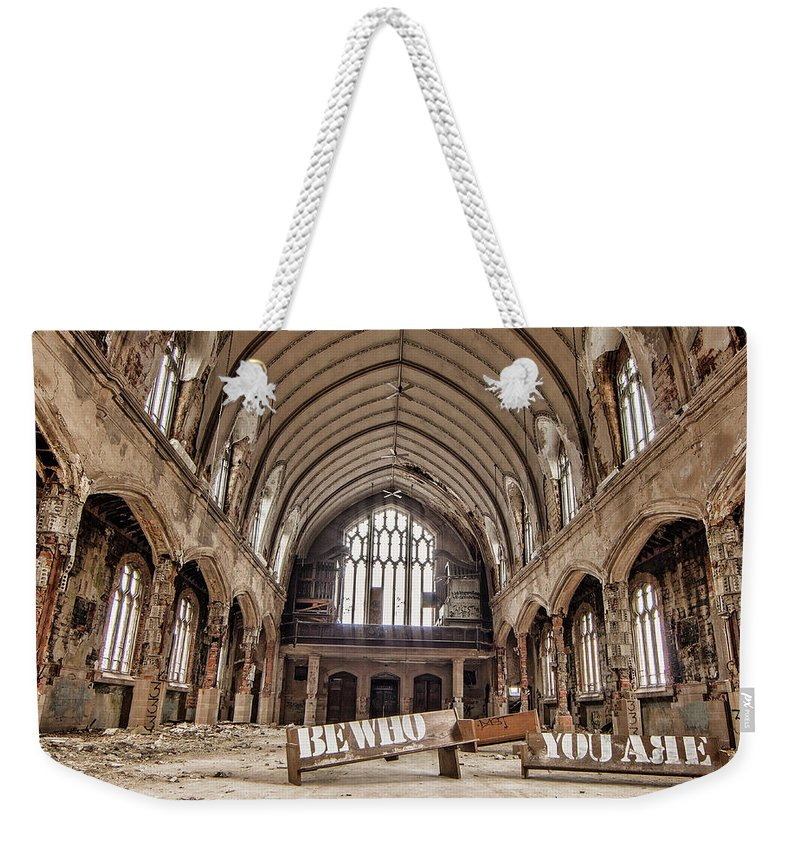 Urban Weekender Tote Bag featuring the photograph No Sanctuary by Pat Eisenberger