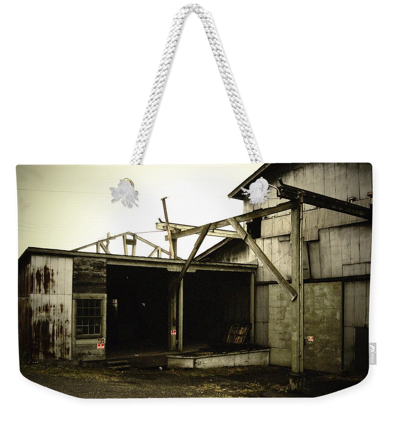 Warehouse Weekender Tote Bag featuring the photograph No Trespassing by Tim Nyberg