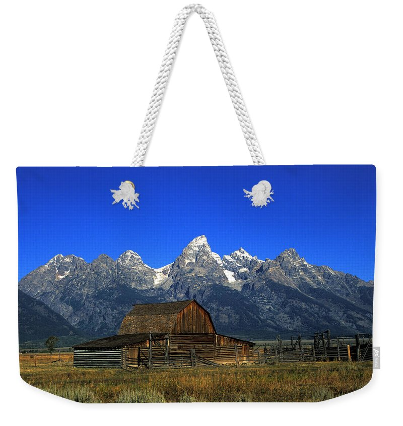 Late Snow Weekender Tote Bag featuring the photograph North Moulton Barn Grand Tetons by Gary Langley
