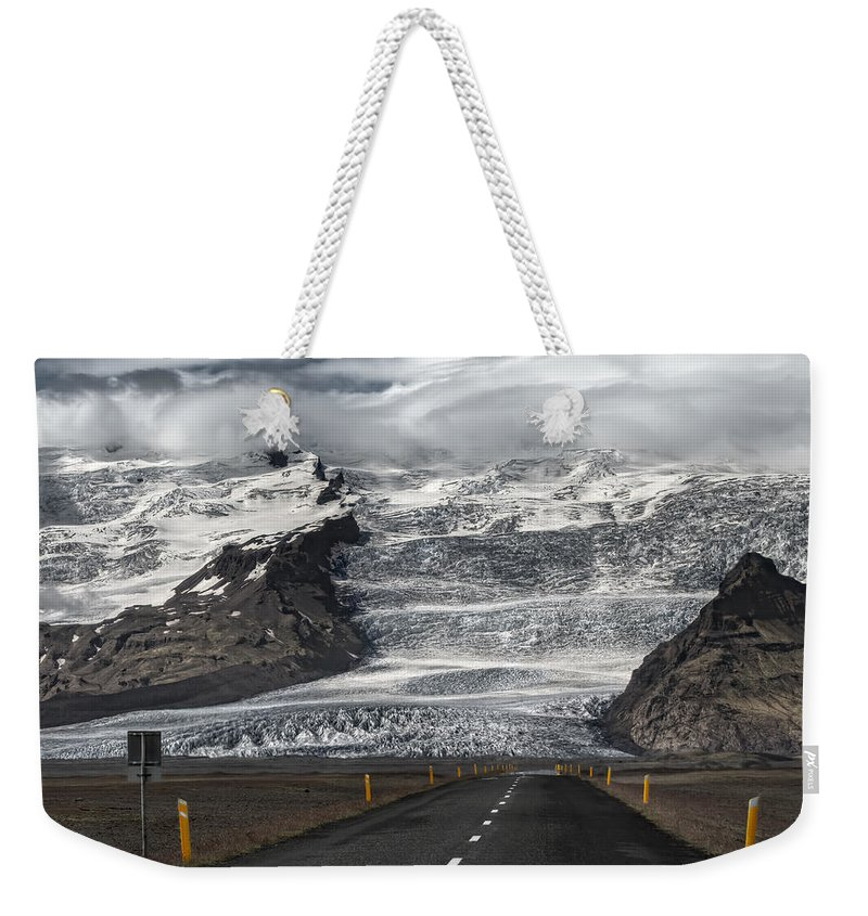 Glacier Weekender Tote Bag featuring the photograph Northbound by Evelina Kremsdorf